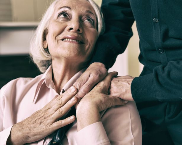 senior woman man holding hands