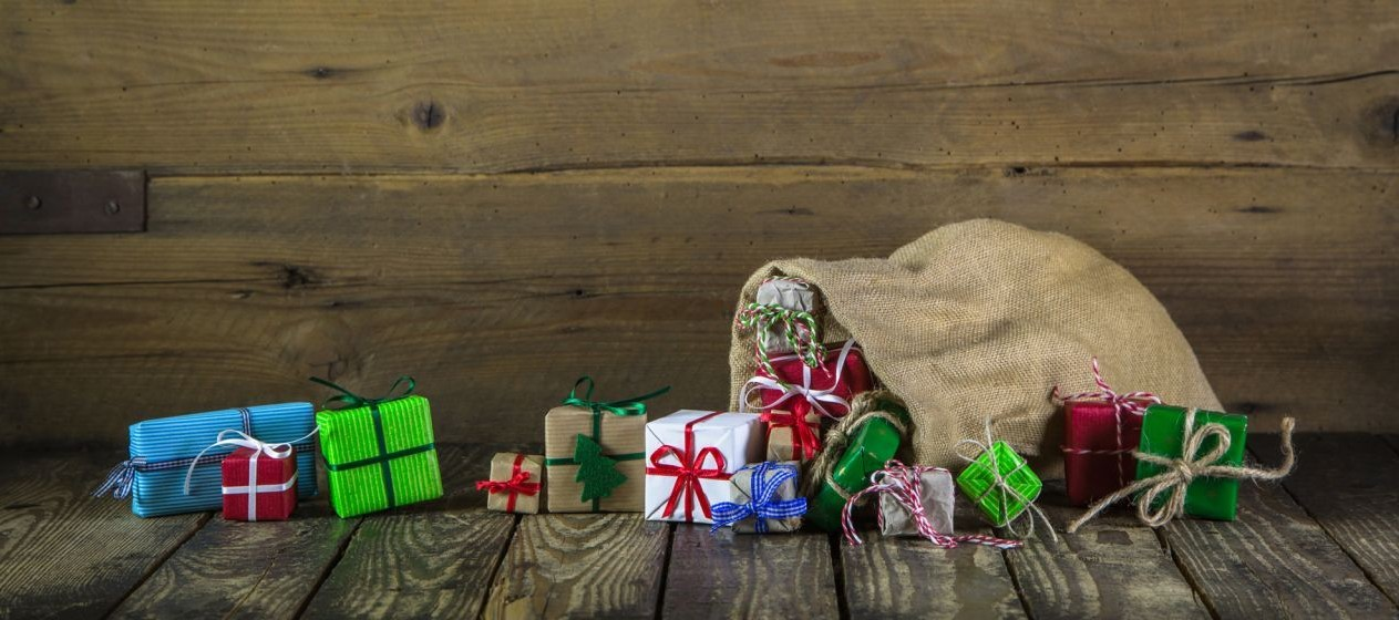 christmas.presents.in.burlap.bag.wooden.background (1)