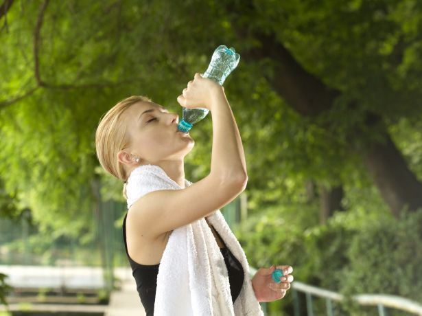 woman drinking water exercise